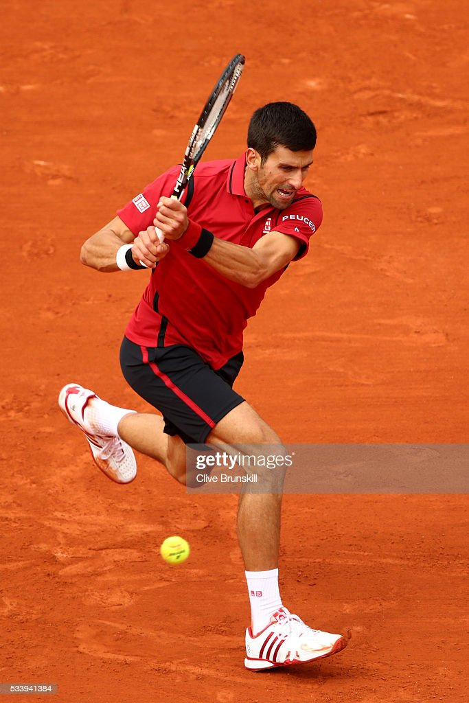 <a gi-track='captionPersonalityLinkClicked' href=/galleries/search?phrase=Novak+Djokovic&family=editorial&specificpeople=588315 ng-click='$event.stopPropagation()'>Novak Djokovic</a> of Serbia plays a backhand during the Men's Singles first round match against Yen-Hsun Lu of Taipei on day three of the 2016 French Open at Roland Garros on May 24, 2016 in Paris, France.