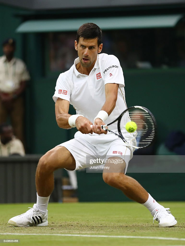 Novak Djokovic of Serbia plays a backhand during the Men's Singles second round match against Adrian Mannarino of France on day three of the Wimbledon Lawn Tennis Championships at the All England Lawn Tennis and Croquet Club on June 29, 2016 in London, England.