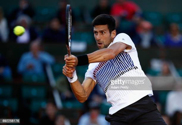 Novak Djokovic of Serbia plays a backhand during the mens singles fourth round match against Albert RamosVinolas of Spain on day eight of the 2017...