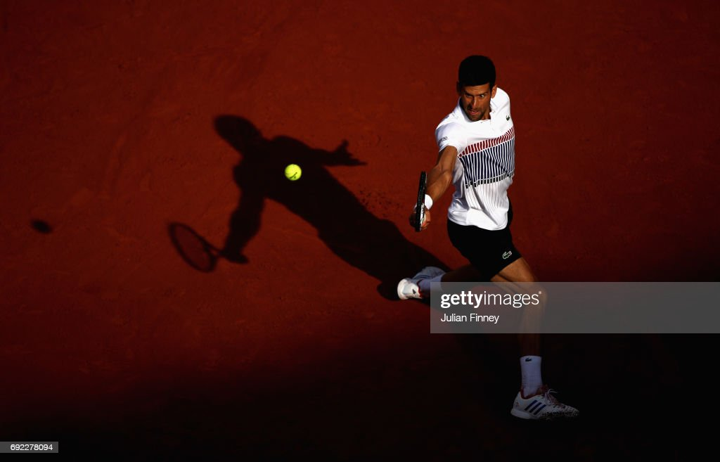 Novak Djokovic of Serbia plays a backhand during the mens singles fourth round match against Albert Ramos-Vinolas of Spain on day eight of the 2017 French Open at Roland Garros on June 4, 2017 in Paris, France.