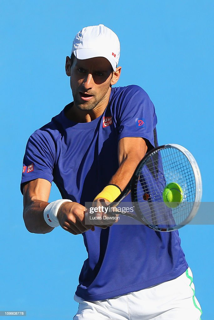 Novak Djokovic of Serbia plays a backhand in a practice session during day ten of the 2013 Australian Open at Melbourne Park on January 23, 2013 in Melbourne, Australia.