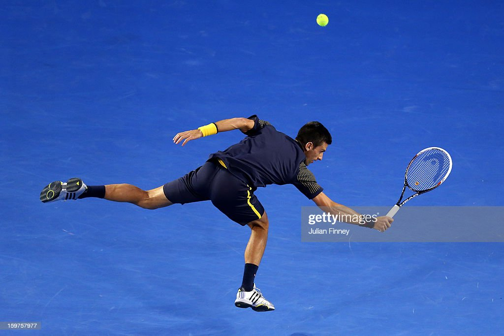 <a gi-track='captionPersonalityLinkClicked' href=/galleries/search?phrase=Novak+Djokovic&family=editorial&specificpeople=588315 ng-click='$event.stopPropagation()'>Novak Djokovic</a> of Serbia plays a backhand in his fourth round match against Stanislas Wawrinka of Switzerland during day seven of the 2013 Australian Open at Melbourne Park on January 20, 2013 in Melbourne, Australia.