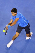 Novak Djokovic of Serbia plays a backhand in his fourth round match against Gilles Muller of Luxembourg during day eight of the 2015 Australian Open...