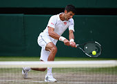 Novak Djokovic of Serbia plays a backhand in his Gentlemens Singles Quarter Final match against Marin Cilic of Croatia during day nine of the...
