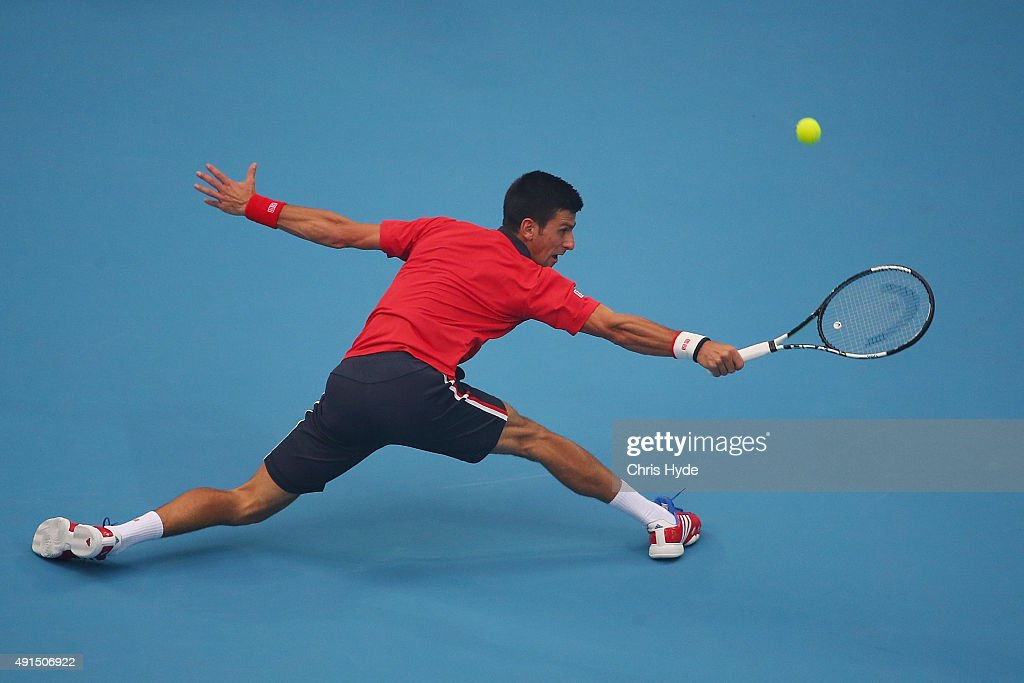 Novak Djokovic of Serbia plays a backhand in his match against SimoneBolelli of Italy during day 4 of the 2015 China Open at the National Tennis Centre on October 6, 2015 in Beijing, China.