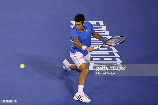 Novak Djokovic of Serbia plays a backhand in his men's final match against Andy Murray of Great Britain during day 14 of the 2015 Australian Open at...