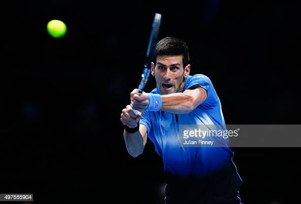 Novak Djokovic of Serbia plays a backhand in his men's singles match against Roger Federer of Switzerland during day three of the Barclays ATP World...