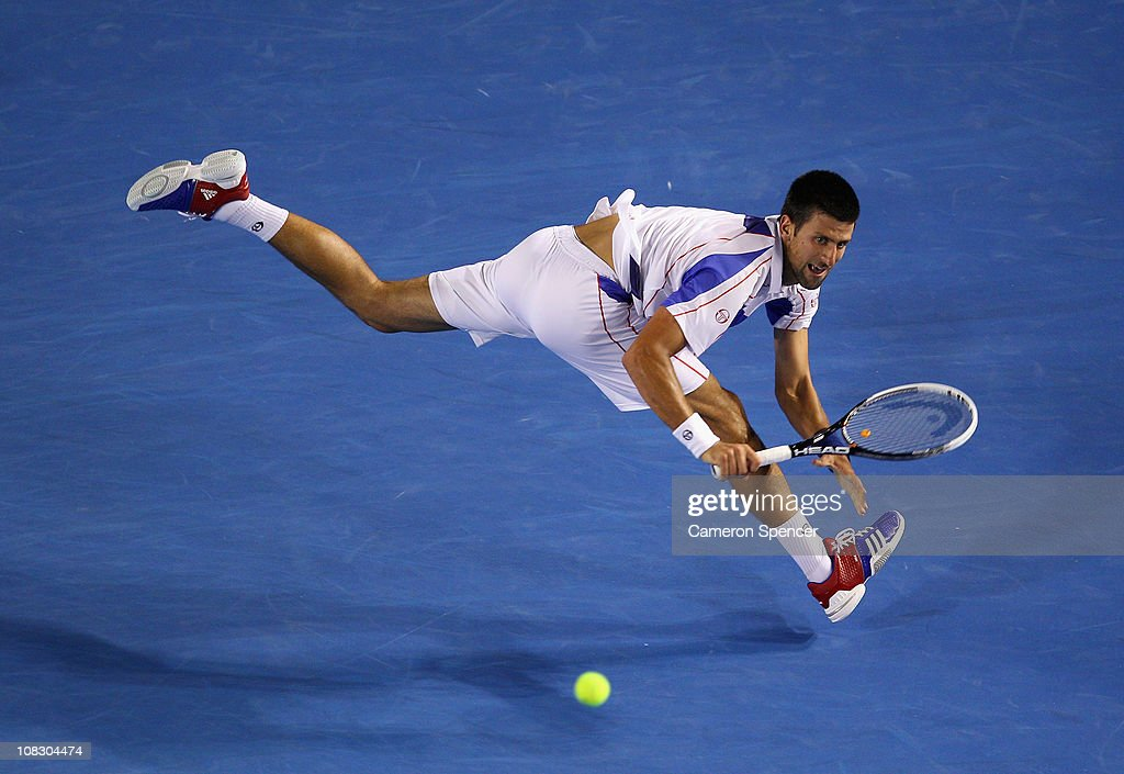 Novak Djokovic of Serbia plays a backhand in his quarterfinal match against Tomas Berdych of the Czech Republic during day nine of the 2011 Australian Open at Melbourne Park on January 25, 2011 in Melbourne, Australia.