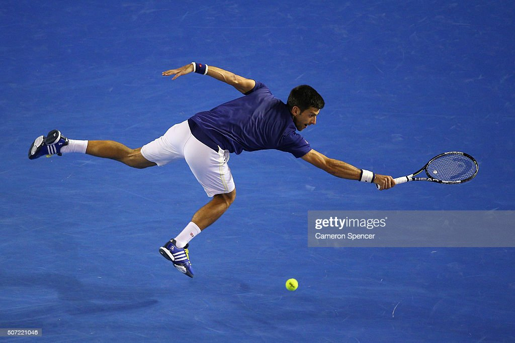 Novak Djokovic of Serbia plays a backhand in his semi final match against Roger Federer of Switzerland during day 11 of the 2016 Australian Open at Melbourne Park on January 28, 2016 in Melbourne, Australia.