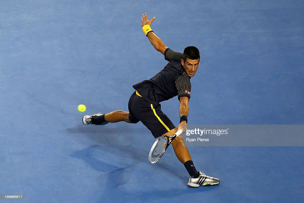 <a gi-track='captionPersonalityLinkClicked' href=/galleries/search?phrase=Novak+Djokovic&family=editorial&specificpeople=588315 ng-click='$event.stopPropagation()'>Novak Djokovic</a> of Serbia plays a backhand in his Semifinal match against David Ferrer of Spain during day eleven of the 2013 Australian Open at Melbourne Park on January 24, 2013 in Melbourne, Australia.