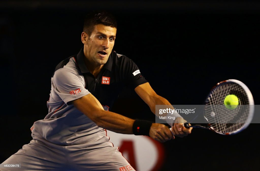 <a gi-track='captionPersonalityLinkClicked' href=/galleries/search?phrase=Novak+Djokovic&family=editorial&specificpeople=588315 ng-click='$event.stopPropagation()'>Novak Djokovic</a> of Serbia plays a backhand in his third round match against Denis Istomin of Uzbekistan during day five of the 2014 Australian Open at Melbourne Park on January 17, 2014 in Melbourne, Australia.