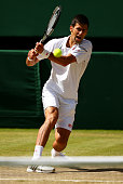 Novak Djokovic of Serbia plays a backhand in the Gentlemens Singles Semi Final match against Richard Gasquet of France during day eleven of the...