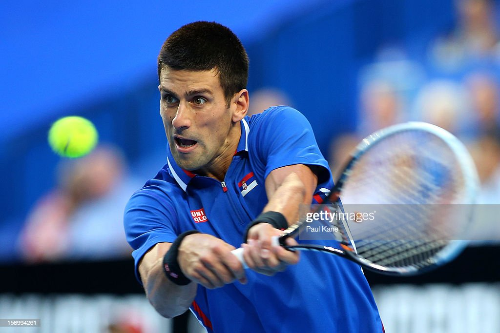 Novak Djokovic of Serbia plays a backhand in the mens singles finals match against Fernando Verdasco of Spain during day eight of the Hopman Cup at Perth Arena on January 5, 2013 in Perth, Australia.