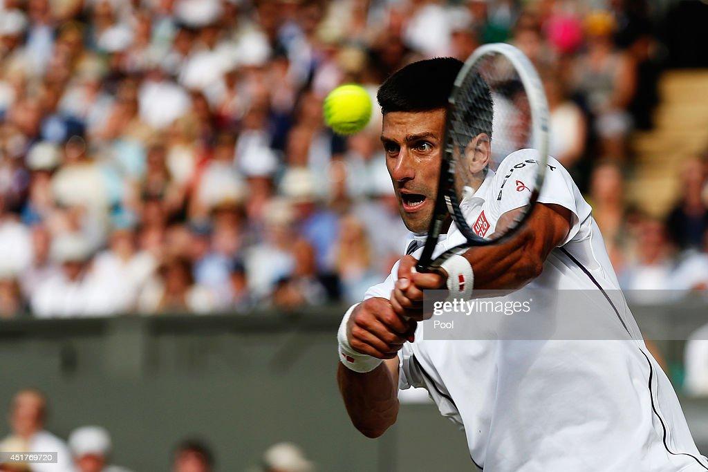 Novak Djokovic of Serbia plays a backhand return during the Gentlemen's Singles Final match against Roger Federer of Switzerland on day thirteen of...