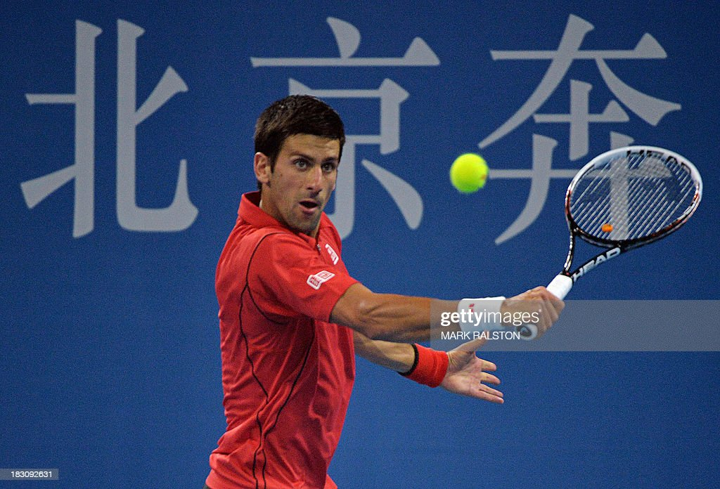 Novak Djokovic of Serbia plays a backhand shot before winning his men's singles quarterfinals match against Sam Querrey of USA at the China Open tennis tournament in Beijing on October 4, 2013. Djokovic went on to win 6-1, 6-2. AFP PHOTO / Mark RALSTON
