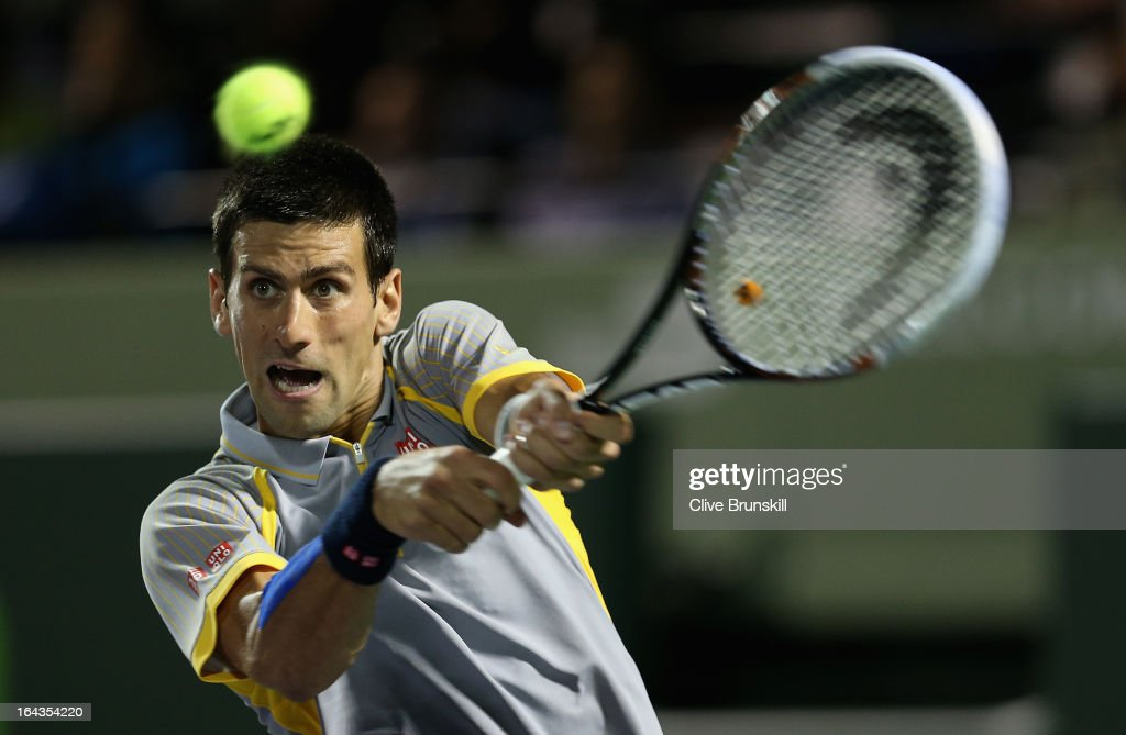 <a gi-track='captionPersonalityLinkClicked' href=/galleries/search?phrase=Novak+Djokovic&family=editorial&specificpeople=588315 ng-click='$event.stopPropagation()'>Novak Djokovic</a> of Serbia plays a backhand to Lukas Rosol of Czech Republic during their second round match at the Sony Open at Crandon Park Tennis Center on March 22, 2013 in Key Biscayne, Florida.