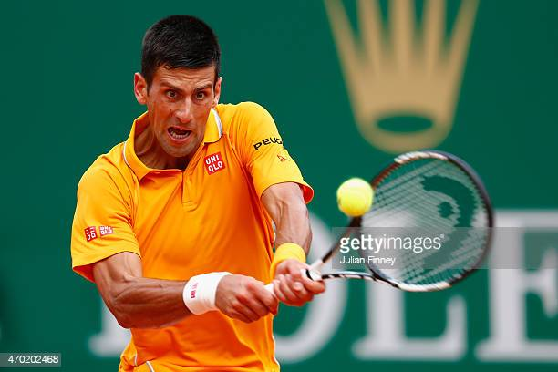 Novak Djokovic of Serbia plays a backhand to Rafael Nadal of Spain in the semi finals during day seven of the Monte Carlo Rolex Masters tennis at the...