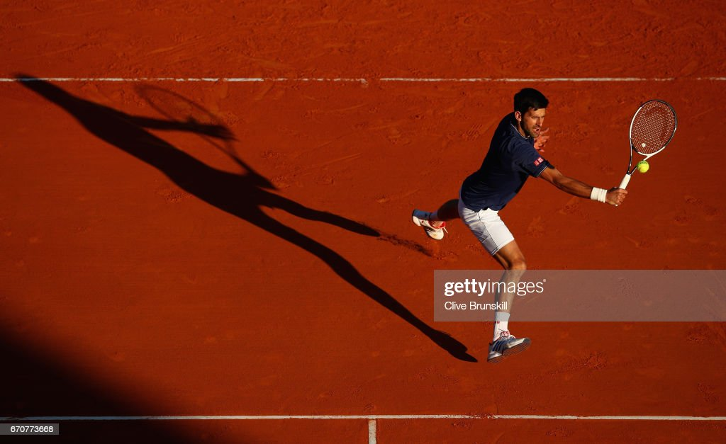 Novak Djokovic of Serbia plays a backhand volley against Pablo Carreno Busta of Spain in his third round match on day five of the Monte Carlo Rolex Masters at Monte-Carlo Sporting Club on April 20, 2017 in Monte-Carlo, Monaco.