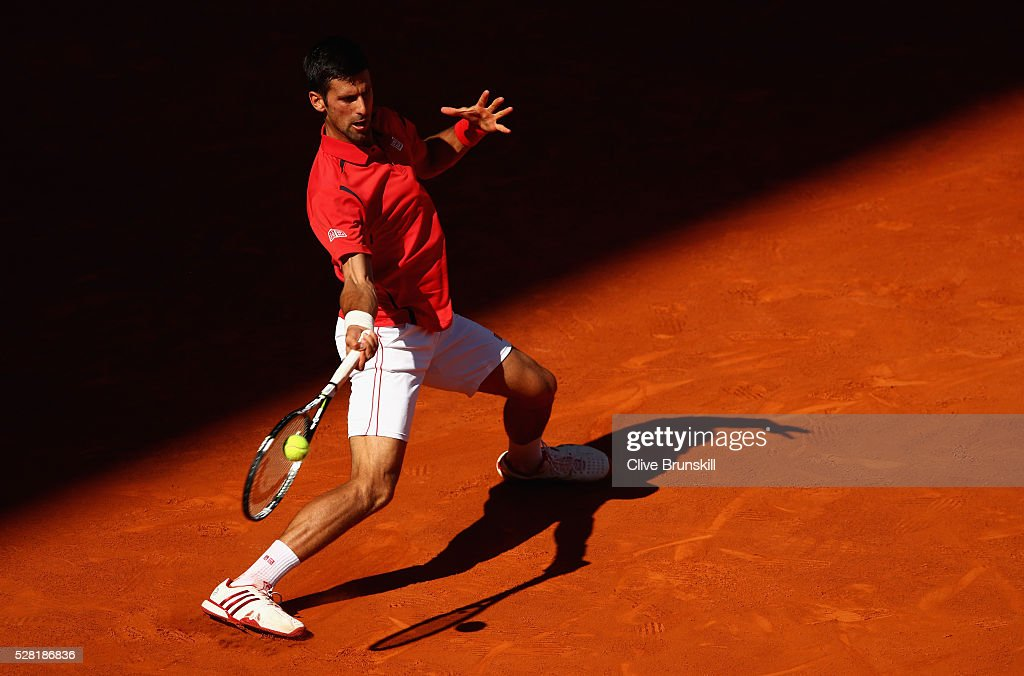 <a gi-track='captionPersonalityLinkClicked' href=/galleries/search?phrase=Novak+Djokovic&family=editorial&specificpeople=588315 ng-click='$event.stopPropagation()'>Novak Djokovic</a> of Serbia plays a forehand against Borna Coric of Croatia in their second round match during day five of the Mutua Madrid Open tennis tournament at the Caja Magica on May 04, 2016 in Madrid.