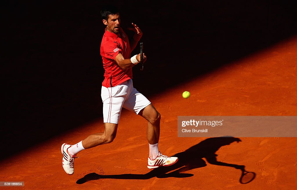 Novak Djokovic of Serbia plays a forehand against Borna Coric of Croatia in their second round match during day five of the Mutua Madrid Open tennis tournament at the Caja Magica on May 04, 2016 in Madrid.