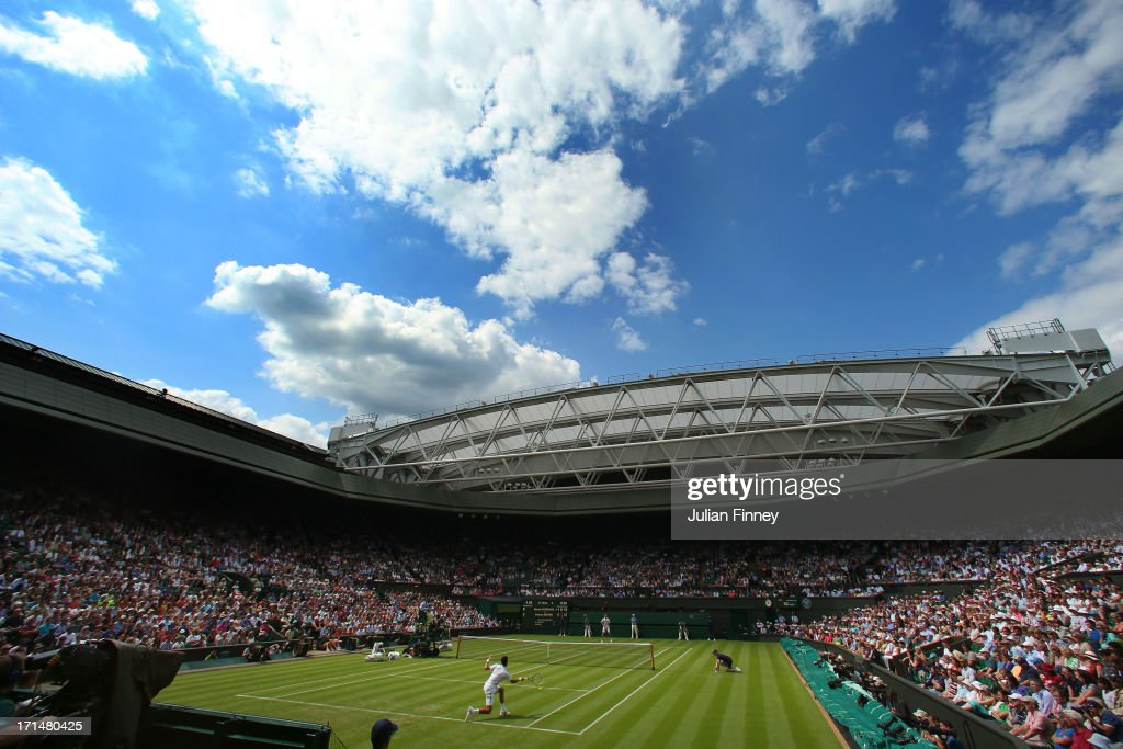 Novak Djokovic of Serbia plays a forehand during his Gentlemen's Singles first round match against Florian Mayer of Germany on Centre Court during day two of the Wimbledon Lawn Tennis Championships at the All England Lawn Tennis and Croquet Club on June 25, 2013 in London, England.