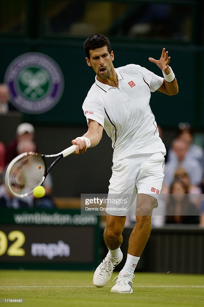 Novak Djokovic of Serbia plays a forehand during his Gentlemen's Singles second round match against Bobby Reynolds of the United States of America on day four of the Wimbledon Lawn Tennis Championships at the All England Lawn Tennis and Croquet Club on June 27, 2013 in London, England.