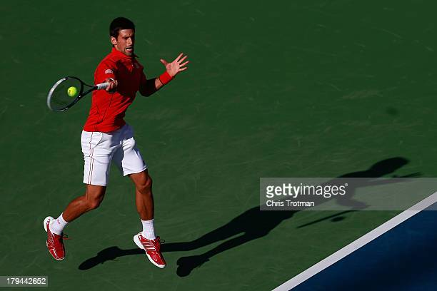 Novak Djokovic of Serbia plays a forehand during his men's singles fourth round match against Marcel Granollers of Spain on Day Nine of the 2013 US...