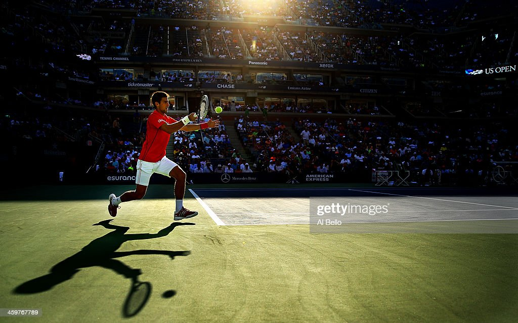 <a gi-track='captionPersonalityLinkClicked' href=/galleries/search?phrase=Novak+Djokovic&family=editorial&specificpeople=588315 ng-click='$event.stopPropagation()'>Novak Djokovic</a> of Serbia plays a forehand during his men's singles fourth round match against Marcel Granollers of Spain on Day Nine of the 2013 US Open at USTA Billie Jean King National Tennis Center on September 3, 2013 in the Flushing neighborhood of the Queens borough of New York City.