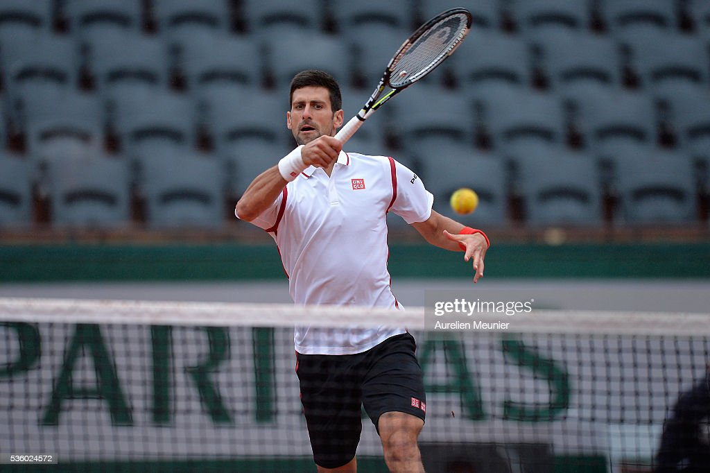 Novak Djokovic of Serbia plays a forehand during his men's singles fourth round match against Roberto Bautista Agut of Spain on day ten of the 2016 French Open at Roland Garros on May 31, 2016 in Paris, France.