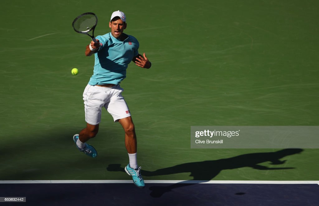 Novak Djokovic of Serbia plays a forehand during his straight set defeat by Nick Kyrgios of Australia in their fourth round match during day ten of the BNP Paribas Open at Indian Wells Tennis Garden on March 15, 2017 in Indian Wells, California.