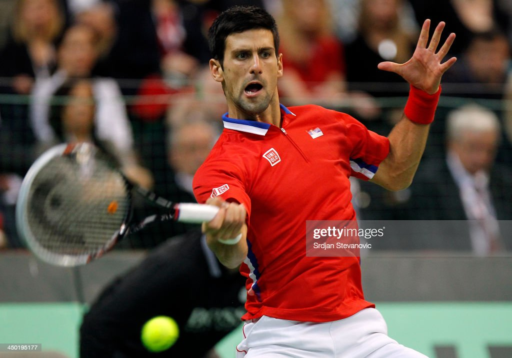 Novak Djokovic of Serbia plays a forehand during the mens singles match between Novak Djokovic of Serbia and Tomas Berdych of Czech Republic on day three of the Davis Cup World Group Final between Serbia and Czech Republic at Kombank Arena on November 17, 2013 in Belgrade, Serbia.