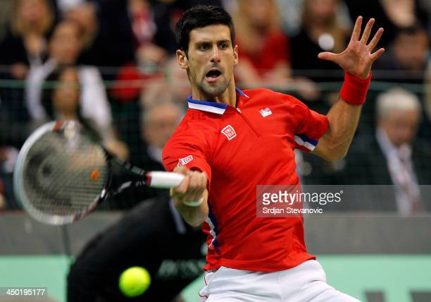 Novak Djokovic of Serbia plays a forehand during the mens singles match between Novak Djokovic of Serbia and Tomas Berdych of Czech Republic on day...