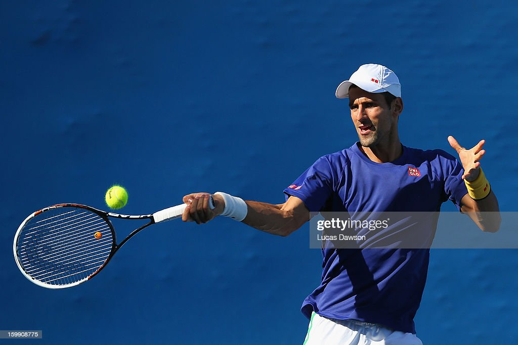 Novak Djokovic of Serbia plays a forehand in a practice session during day ten of the 2013 Australian Open at Melbourne Park on January 23, 2013 in Melbourne, Australia.
