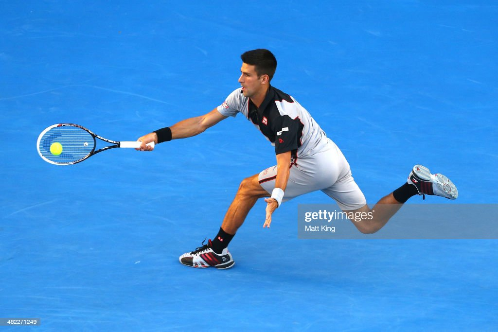 Novak Djokovic of Serbia plays a forehand in his first round match against Lukas Lacko of Slovakia during day one of the 2014 Australian Open at Melbourne Park on January 13, 2014 in Melbourne, Australia.