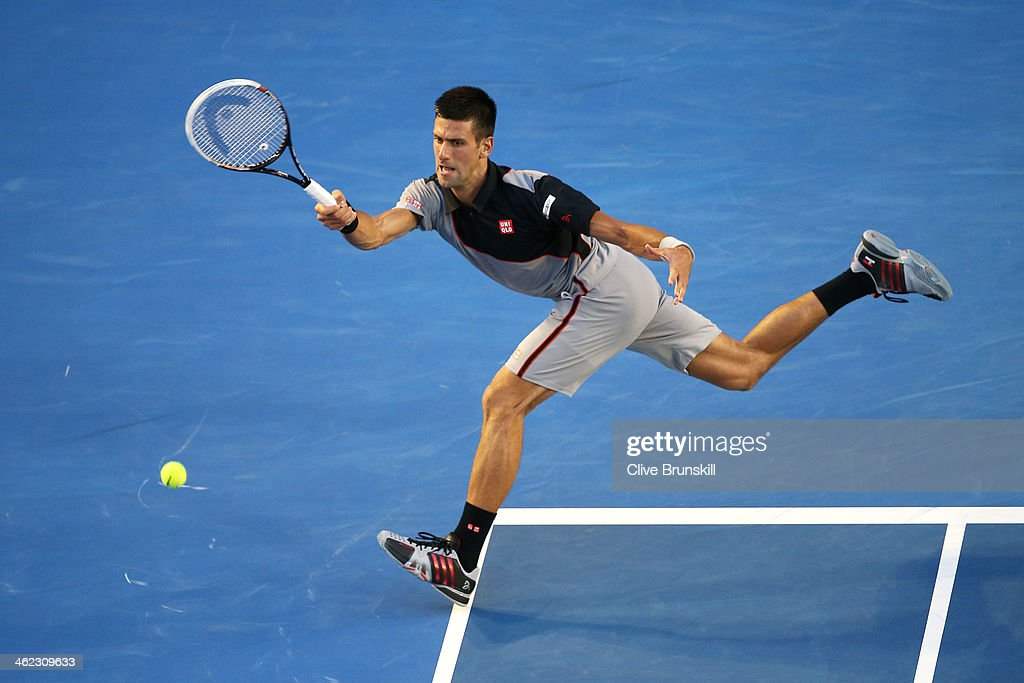 <a gi-track='captionPersonalityLinkClicked' href=/galleries/search?phrase=Novak+Djokovic&family=editorial&specificpeople=588315 ng-click='$event.stopPropagation()'>Novak Djokovic</a> of Serbia plays a forehand in his first round match against Lukas Lacko of Slovakia during day one of the 2014 Australian Open at Melbourne Park on January 13, 2014 in Melbourne, Australia.
