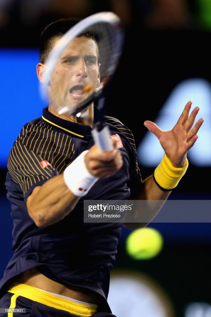 Novak Djokovic of Serbia plays a forehand in his fourth round match against Stanislas Wawrinka of Switzerland during day seven of the 2013 Australian Open at Melbourne Park on January 20, 2013 in Melbourne, Australia.