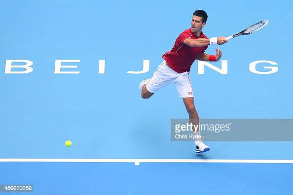 Novak Djokovic of Serbia plays a forehand in his semifinal match against Andy Murray of Great Britain during day eight of the China Open at the China...