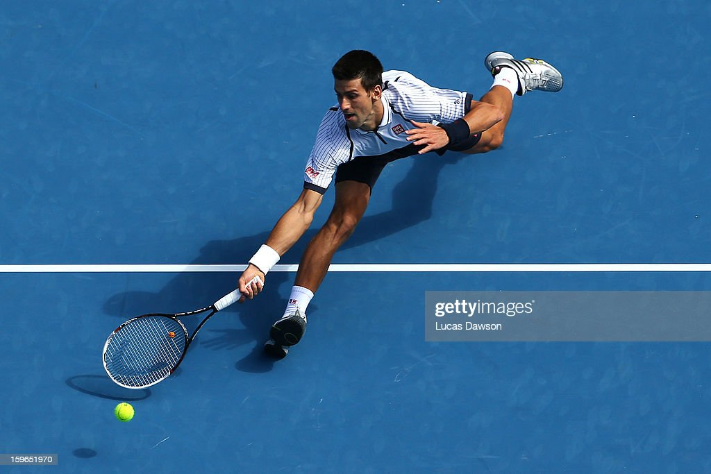 <a gi-track='captionPersonalityLinkClicked' href=/galleries/search?phrase=Novak+Djokovic&family=editorial&specificpeople=588315 ng-click='$event.stopPropagation()'>Novak Djokovic</a> of Serbia plays a forehand in his third round match against Radek Stepanek of the Czech Republic during day five of the 2013 Australian Open at Melbourne Park on January 18, 2013 in Melbourne, Australia.