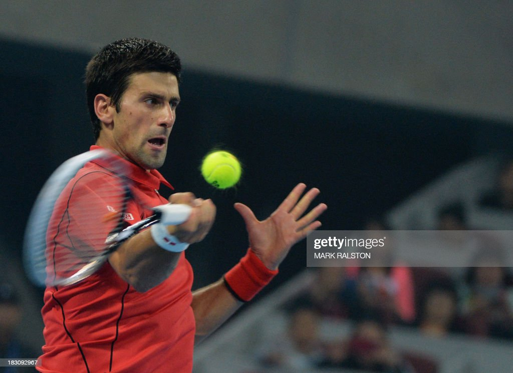 Novak Djokovic of Serbia plays a forehand shot before winning his men's singles quarterfinals match against Sam Querrey of USA at the China Open tennis tournament in Beijing on October 4, 2013. Djokovic went on to win 6-1, 6-2. AFP PHOTO / Mark RALSTON