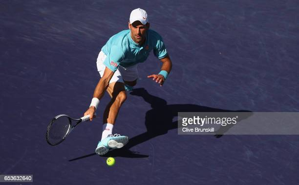 Novak Djokovic of Serbia plays a forehand volley during his straight set defeat by Nick Kyrgios of Australia in their fourth round match during day...