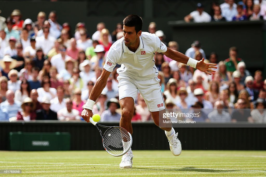 Novak Djokovic of Serbia plays a low down volley during the Gentlemen's Singles Final match against Roger Federer of Switzerland on day thirteen of...