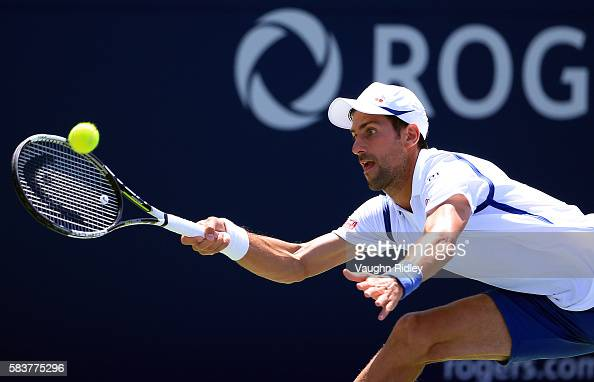 Novak Djokovic of Serbia plays a shot against Gilles Muller of Luxembourg on Day 3 of the Rogers Cup at the Aviva Centre on July 27 2016 in Toronto...