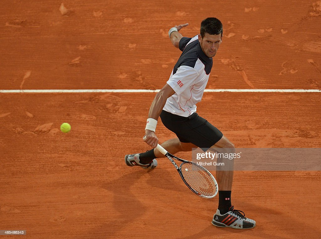 <a gi-track='captionPersonalityLinkClicked' href=/galleries/search?phrase=Novak+Djokovic&family=editorial&specificpeople=588315 ng-click='$event.stopPropagation()'>Novak Djokovic</a> of Serbia plays a shot against Guilermo Garcia-Lopez of Spain during their quarter final on day six of the ATP Monte Carlo Masters, at the Monte-Carlo Country Club on April 18, 2014 in Monte-Carlo, Monaco.