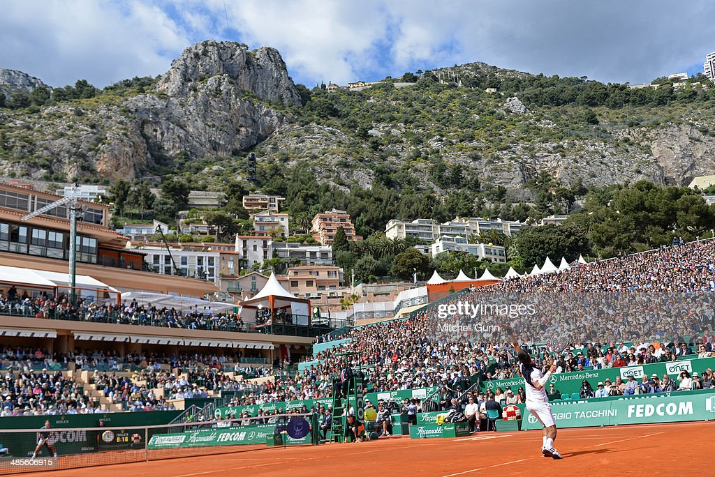 Novak Djokovic of Serbia plays a shot against Roger Federer of Switzerland during their semi final match on day seven of the ATP Monte Carlo Masters...