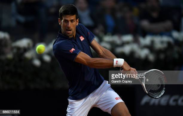 Novak Djokovic of Serbia plays a shot during his semi final match against Dominic Thiem of Austria in The Internazionali BNL d'Italia 2017 at Foro...