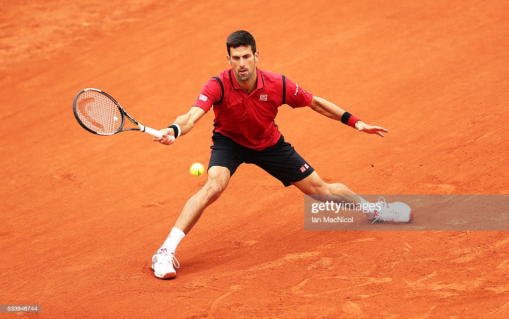 <a gi-track='captionPersonalityLinkClicked' href=/galleries/search?phrase=Novak+Djokovic&family=editorial&specificpeople=588315 ng-click='$event.stopPropagation()'>Novak Djokovic</a> of Serbia plays a shot during the Men's Singles first round match against Yen-Hsmen of Chinese Taipei on day three of the 2016 French Open at Roland Garros on May 24, 2016 in Paris, France .
