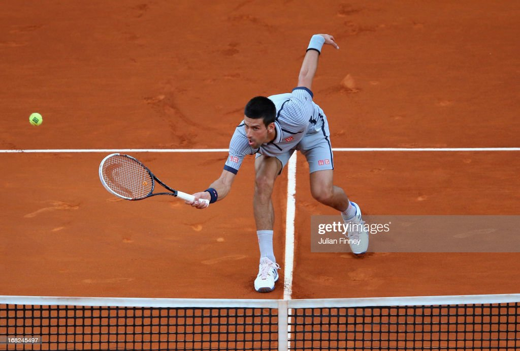 <a gi-track='captionPersonalityLinkClicked' href=/galleries/search?phrase=Novak+Djokovic&family=editorial&specificpeople=588315 ng-click='$event.stopPropagation()'>Novak Djokovic</a> of Serbia plays a volley in his match against Grigor Dimitrov of Bulgaria during day four of the Mutua Madrid Open tennis tournament at the Caja Magica on May 7, 2013 in Madrid, Spain.