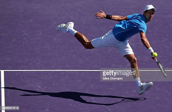 Novak Djokovic of Serbia plays in the Men's Final of the Miami Open presented by Itau against Andy Murray of Great Brittain at Crandon Park Tennis...