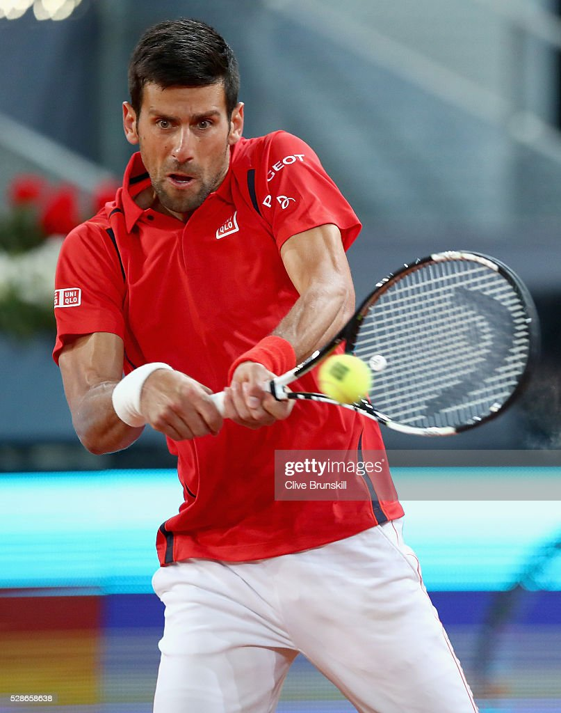 Novak Djokovic of Serbia plays s backhand against Milos Raonic of Canada in their quarter final round match during day seven of the Mutua Madrid Open tennis tournament at the Caja Magica on May 06, 2016 in Madrid,Spain.