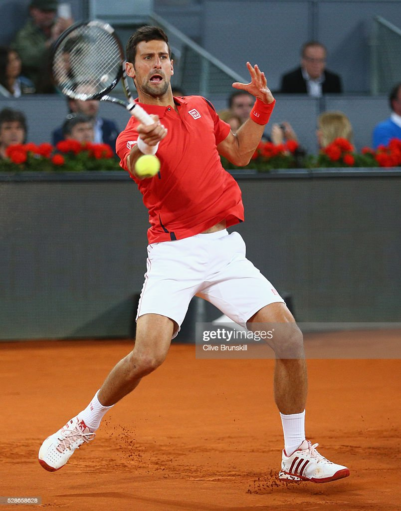 Novak Djokovic of Serbia plays s forehand against Milos Raonic of Canada in their quarter final round match during day seven of the Mutua Madrid Open tennis tournament at the Caja Magica on May 06, 2016 in Madrid,Spain.